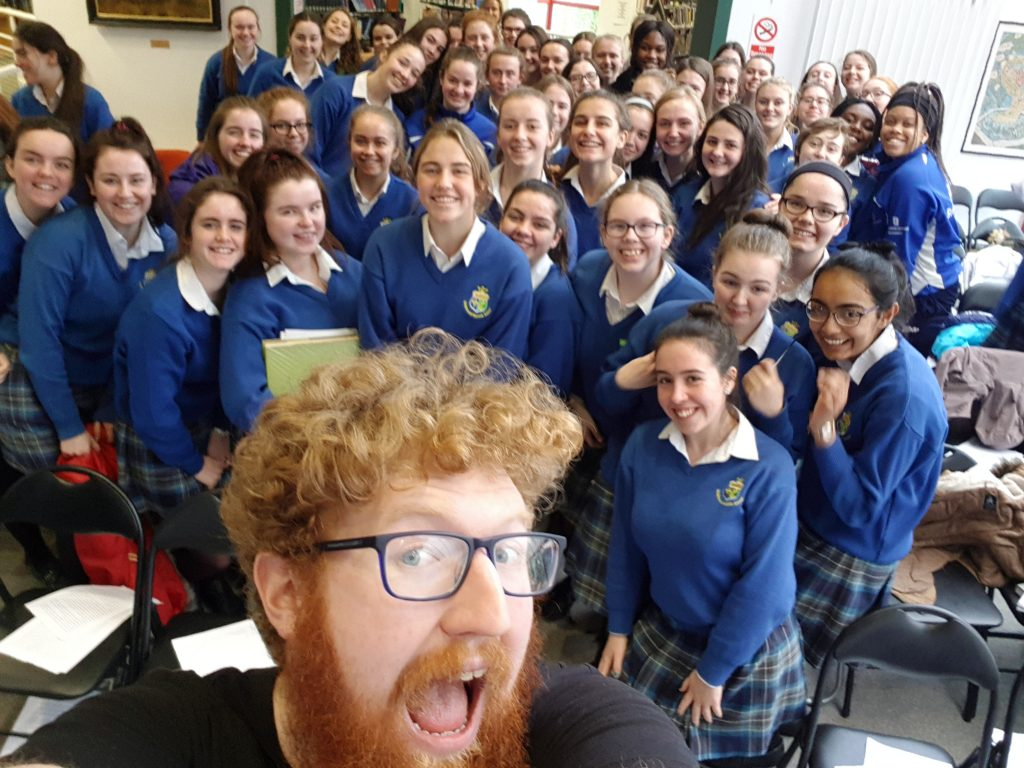 Photo of Dave with a writing class