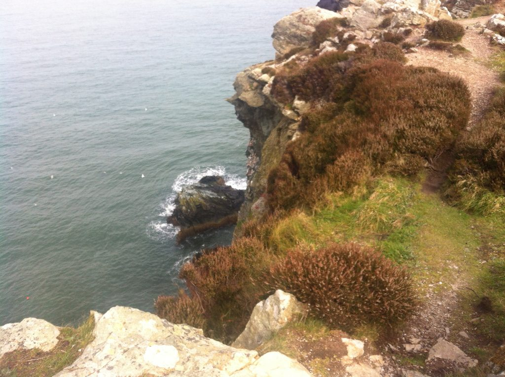 Photo of a cliff edge over the Irish sea