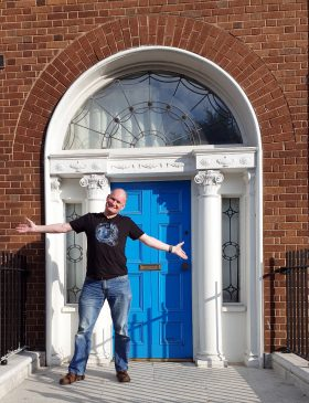 Photo of the author at a Georgian door on Mountjoy Square